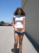 Unzipping her pants outside the mall