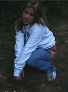 Teen Cass is alone in the park and needs a hand with her jeans!